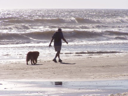 man-and-dog-on-beach